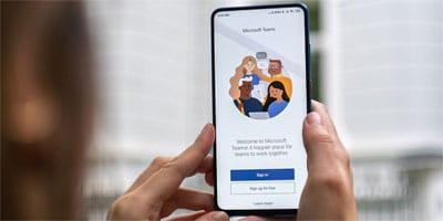 Mobile phone screen shows Microsoft Teams MobileApp